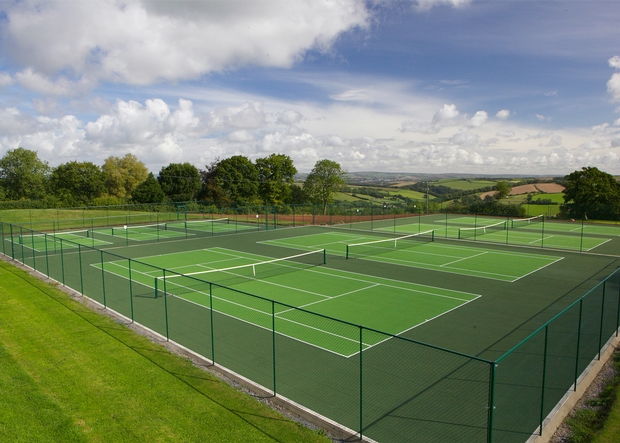Take inspiration from Wimbledon and book a tennis break at Highbullen Hotel Golf & Country Club